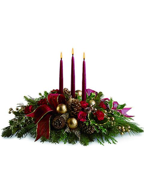 centrotavola natalizio con tre candele