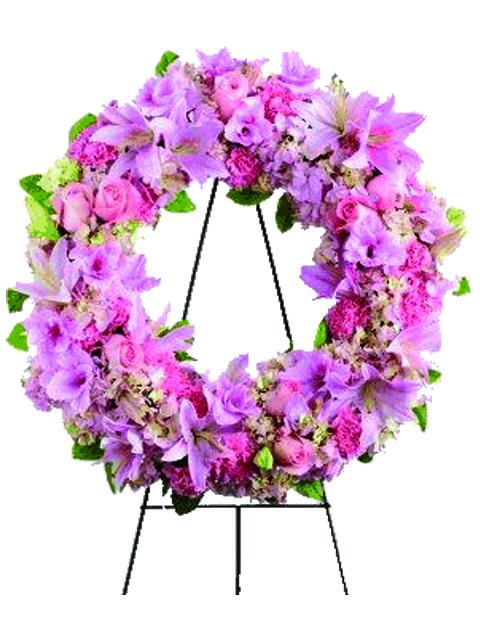 corona funebre di gigli e rose rosa